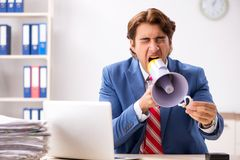 The deaf employee using hearing aid in office. Deaf employee using hearing aid in office royalty free stock images
