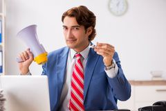 The deaf employee using hearing aid in office. Deaf employee using hearing aid in office stock photos