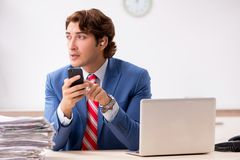 The deaf employee using hearing aid in office. Deaf employee using hearing aid in office royalty free stock image