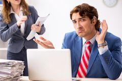 The deaf employee using hearing aid talking to boss. Deaf employee using hearing aid talking to boss royalty free stock images