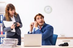 The deaf employee using hearing aid talking to boss. Deaf employee using hearing aid talking to boss stock photography