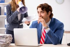 The deaf employee using hearing aid talking to boss. Deaf employee using hearing aid talking to boss royalty free stock photos