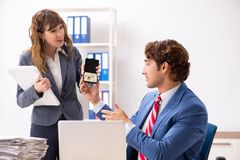 The deaf employee using hearing aid talking to boss. Deaf employee using hearing aid talking to boss stock image