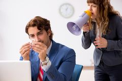 The deaf employee using hearing aid talking to boss. Deaf employee using hearing aid talking to boss stock photos