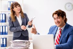 The deaf employee using hearing aid talking to boss. Deaf employee using hearing aid talking to boss royalty free stock photo