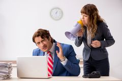 The deaf employee using hearing aid talking to boss. Deaf employee using hearing aid talking to boss royalty free stock photography
