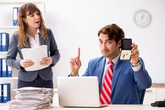 The deaf employee using hearing aid talking to boss. Deaf employee using hearing aid talking to boss royalty free stock image