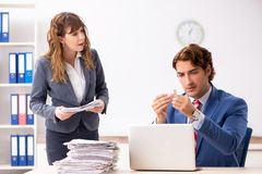 The deaf employee using hearing aid talking to boss stock photos