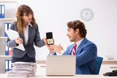 The deaf employee using hearing aid talking to boss royalty free stock images