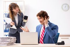 The deaf employee using hearing aid talking to boss stock photo