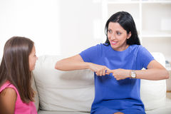 Deaf girl learning sign language Stock Photos