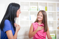 Deaf girl learning sign language Stock Image