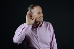 Deaf man. Can not hear you at all Royalty Free Stock Photo