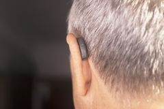 Deaf man hearing aid ear Stock Photography