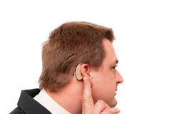 Deaf man's hearing aid Stock Image
