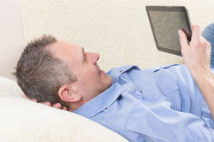 Deaf man using tablet. Smiling Deaf man talking using tablet at home stock images