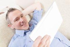 Deaf man using tablet. Smiling Deaf man talking using tablet at home Stock Photos