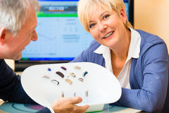 Deaf people taking a hearing test Royalty Free Stock Photography