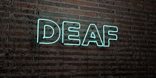 DEAF -Realistic Neon Sign on Brick Wall background - 3D rendered royalty free stock image Royalty Free Stock Photo