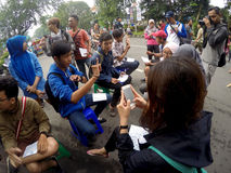 Deaf sign language. Is being taught to the people in a public space in the city of Solo, Central Java, Indonesia stock photography