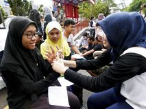 Deaf. Was socializing sign language in the city of Solo, Central Java, Indonesia royalty free stock image