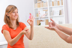 Deaf woman learning sign language royalty free stock images