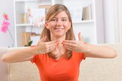 Deaf woman using sign language stock photos