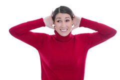 Deafness: young isolated woman in red has hearing problems. Stock Images
