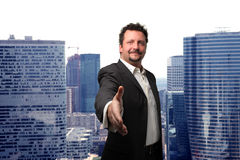 Deal. A business man with an open hand ready to seal a deal Royalty Free Stock Photography