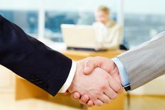 Deal. Close-up of corporate deal on the background of secretary Royalty Free Stock Image