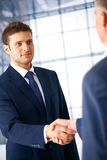 Deal. Business people shaking hands, coming to an agreement in the office Royalty Free Stock Photography