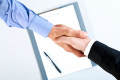 Deal. Image of final of deal over paper with pen Stock Image