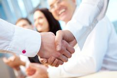 Deal. Image of business handshake after signing new contract stock image