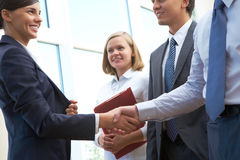 Deal. Image of business partners handshake after signing new contract Royalty Free Stock Photos