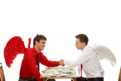 Deal. Image of deal between god and devil over table with dollars royalty free stock image