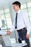 Deal. Portrait of businessman handshaking after signing contract Stock Images