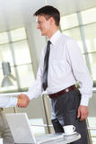 Deal. Portrait of businessman handshaking after signing contract Royalty Free Stock Images