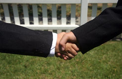 Deal. Handshake between two men for an agreed upon business deal Royalty Free Stock Photography