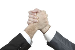 Deal. Two businessman shaking hands as a result of a good deal/successful investment Stock Photos