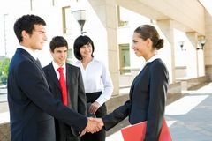 Deal. Photo of successful people handshaking after striking deal outdoors at meeting Royalty Free Stock Images