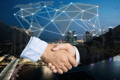 Deal or agreement business concept, handshake double exposure, c. Ooperation or partnership business with global connection partnership map stock photography