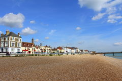 Deal beach English channel United Kingdom. Scenic view of serene channel water,the long pebble beach and  beach-side buildings of Deal town.Deal is a town in Stock Images