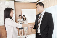 Deal between businessman and businesswoman Stock Photo