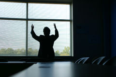 The deal is closed. Silhouette of businessman with hands in the air in triumph Stock Image