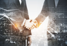 Deal concept. Businessmen shaking hands on night city background. Double exposure. Deal concept Royalty Free Stock Image
