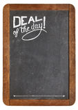 Deal of the day on blackboard Stock Photo