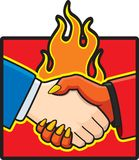Deal with the Devil. A businessman shaking hands with the devil Royalty Free Stock Photo