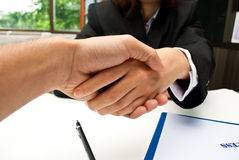 Deal done. Businessmen shaking hands over a desk Stock Photos