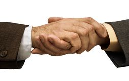 Deal is done. Two businessmen shaking hands ,focus point on the center of the photo Stock Images