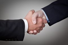 Deal Done. Two Businessman shake their hands on successful Deal Royalty Free Stock Image